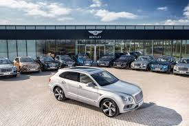 orange bentley bentayga first bentley bentayga deliveries kick off in crewe england