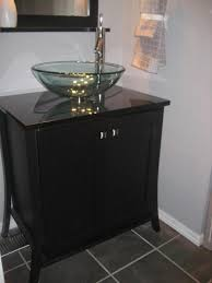 riveting black bathroom vanity with vessel sink of clear glass