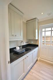 grey kitchen units with black granite worktops matching partridge grey utility with black granite worktops
