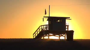 lifeguard house silhouette at tropical sunset golden hour santa