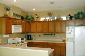 ideas for top of kitchen cabinets the tricks you need to for decorating above cabinets laurel