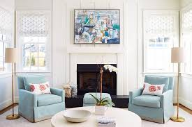 ocean blue slipcovered chairs flanking fireplace transitional
