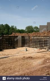 forms for poured concrete basement walls of new home stock photo