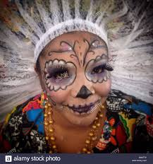 a catrina dressed as a oaxacan tehuana in mexico city the day of