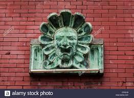 gargoyle ornament on brick wall stock photo royalty free image