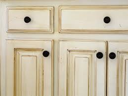 how to distress kitchen cabinets antiquing kitchen cabinets with stain using chalk paint for oak