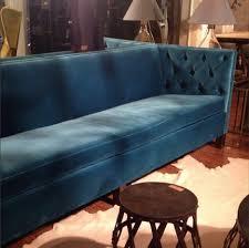blue velvet sofa from bobo apartment therapy