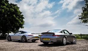 porsche turbo poster porsche 911 face off 991 turbocharged carrera vs 996 turbo