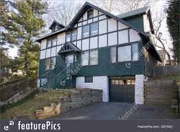 photo of green tudor old fashioned house