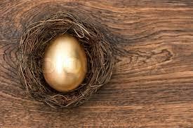 wooden easter eggs golden easter egg in birds nest on vintage wooden background