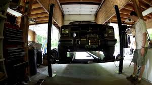 chevy suburban 2500 on the lift 4 post atlas garage pro ext