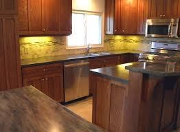 under cabinet backsplash classic kitchen look with oak cabinets