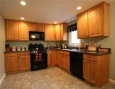 alternate view of kitchen honey oak cabinets slate tile floor