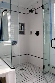 black and white bathroom tiles in a small bathroom white washbasin