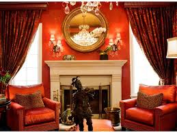 area rug painting fireplace surround decorative pillows red walls