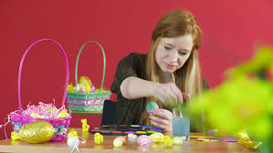 Decorating Easter Eggs Video by Mother And Son Decorating Easter Eggs On Table Indoor Stock
