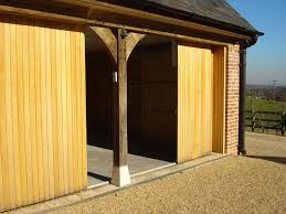 elegant sliding garage doors in natural colour amaza design