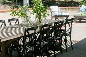 Patio Dining Table Gray X Based Outdoor Dining Table With Black French Cafe Chairs