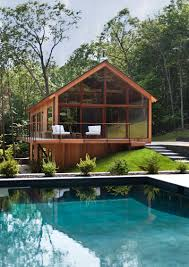 this wooden house with a swimming pool is tucked away in the