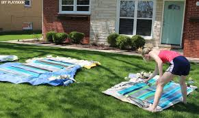 Painting An Outdoor Rug Diy Outdoor Painted Rug With Spaypaint The Diy Playbook