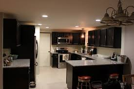 lighting for kitchen flooring azul platino granite with barstool also recessed