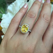 canary engagement ring 3 25 carat oval halo engagement ring canary yellow and white