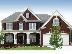 grand entry into this 6 bedroom luxury home luxury house plan