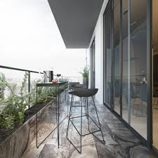small balcony in apartment black chair black table life plant in