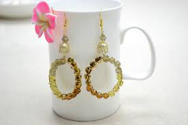 creative earrings creative dangle hoop earrings pictures photos and images for