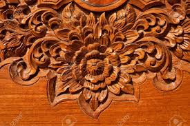 wood engraving thai style teak wood engraving stock photo picture and royalty