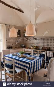 rustic country kitchen with decorative tiling la cornue range