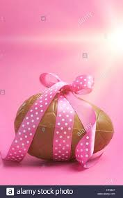 pink polka dot ribbon large happy easter chocolate easter egg with pink polka dot ribbon
