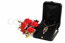 gold necklace box images Precious gold necklace in open gift box with flowers stock photo jpg