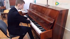 Blind Boy Plays Piano Inspirational Video Shows Self Taught 15 Year Old Playing The