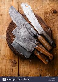 butcher meat cleavers large chef s knives on chopping board block butcher meat cleavers large chef s knives on chopping board block on wooden background