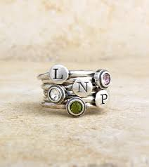 stackable engraved mothers rings silver initial and birthstone s ring by nelle and lizzy