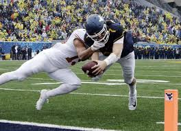 West Virginia travel express images West virginia qb will grier hurts throwing hand vs texas san jpg