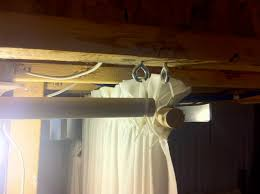 uses fabric hooks ties and wood to cover walls diy