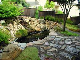 large backyard garden house design with koi ponds and waterfall