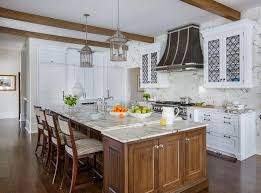 white kitchen cabinets with wood beams white kitchen cabinets with iron moroccan trellis grille