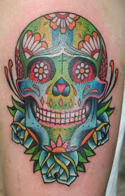 celebrate the day of the dead with sugar skull tattoos