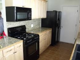 Kitchen Design With Black Appliances Narrow Kitchens With Black Appliances And Marble Countertop Idea