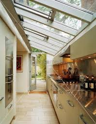 galley kitchen extension ideas glass roof above kitchen counter with spotlights reflected in