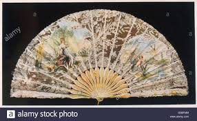 a highly ornamental lace folding fan by duvelleroy of with
