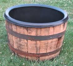 madly whimsical wine barrel planter ideas inhabit zone