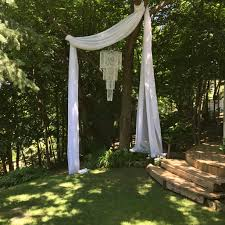 chandelier and fabric dress up the perfect tree for backyard