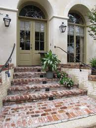 green and the cream stucco with the brick paver old st louis