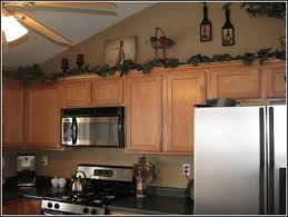 kitchen theme ideas for decorating decorating tops of kitchen cabinets captainwalt