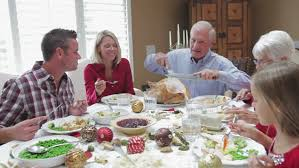 family saying grace before meal on r3d stock