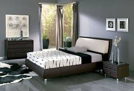 light gray open bedroom with large window screens and wall panels